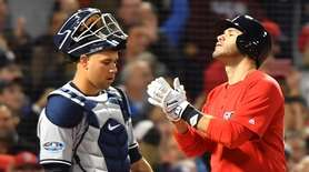 Yankees catcher Gary Sanchez looks on as J.D.
