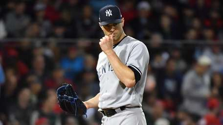 New York Yankees starting pitcher J.A. Happ reacts