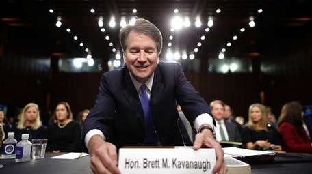 Judge Brett Kavanaugh organizes his desk before testifying