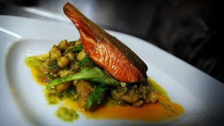 Scottish salmon with braised beans and arugula is