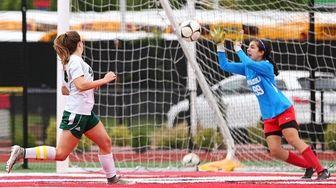 Goalie Isabella Polanco of Mineola tries to make