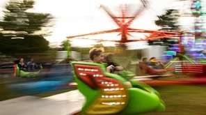 Kids enjoy the carnival rides at the fall