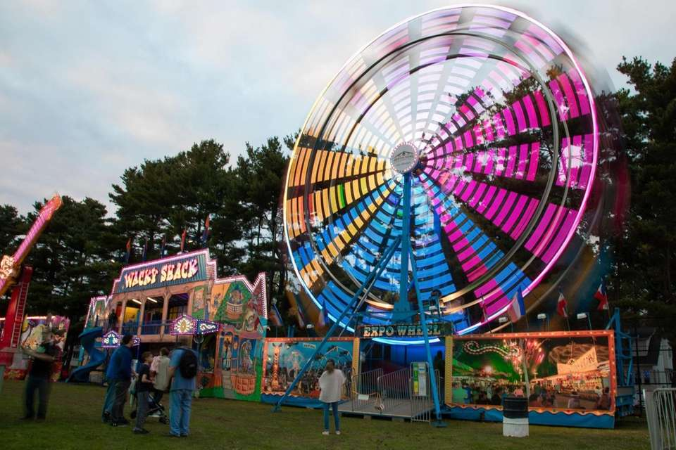 Rides put on a colorful light show at