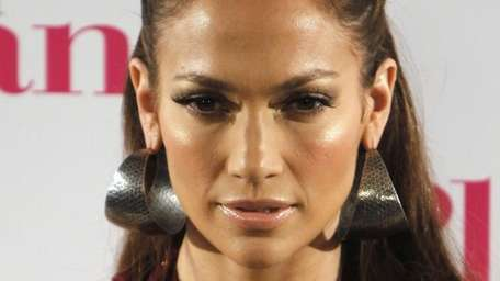 Jennifer Lopez poses during a photo-call for the