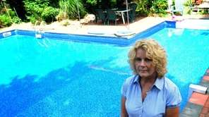 Paulette Bates stands by her backyard pool in