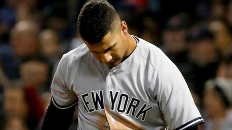 New York Yankees' Gleyber Torres reacts after striking