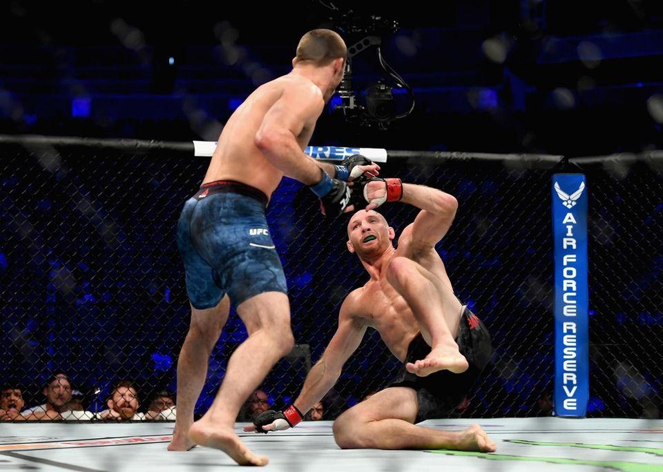 Tony Martin (L) knocks down Ryan LaFlare (R)