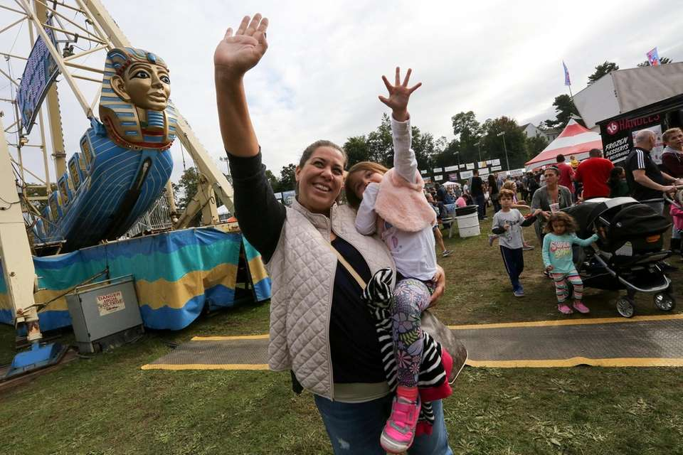 Tracy Aisenbrey, and her daughter, Stephanie, 3, wave