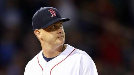 Steven Wright of the Red Sox looks on