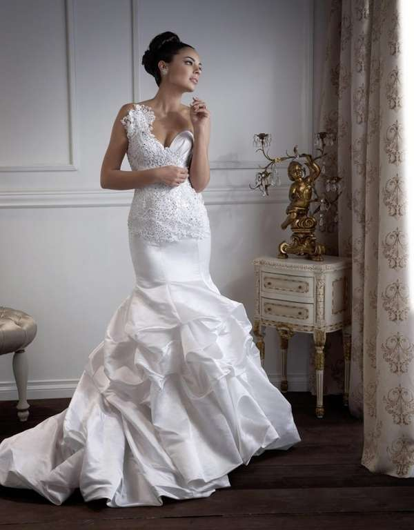 This Marina K Couture bridal gown is featured