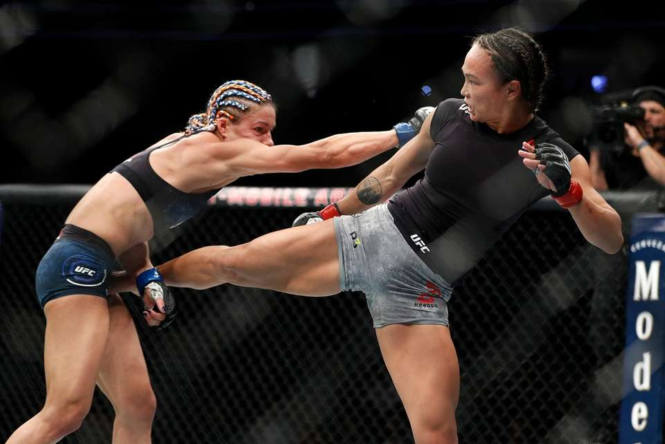 Michelle Waterson kicks Felice Herrig during a women's