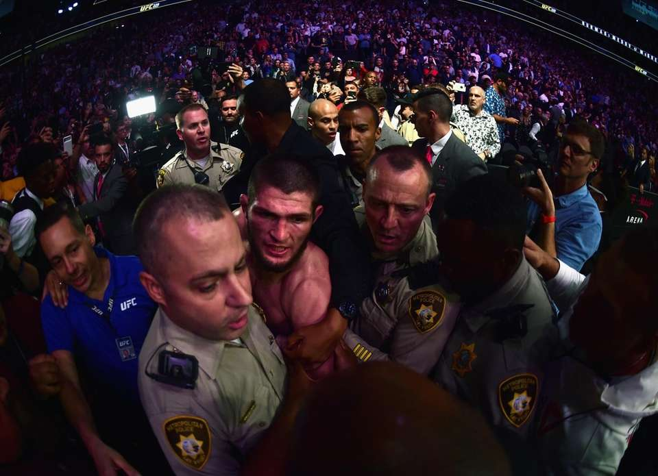 Khabib Nurmagomedov of Russia is escorted out of