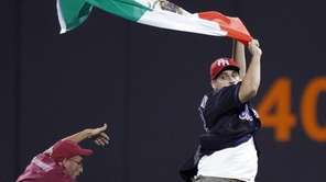 A Citi Field security guard tries to tackle