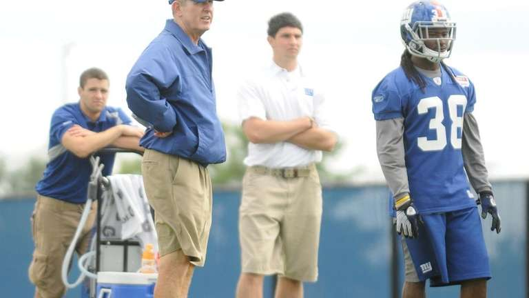 New York Giants head coach Tom Coughlin observes