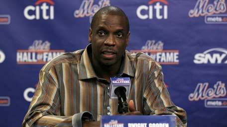 Former player Dwight Gooden speaks during a press