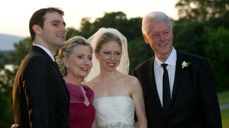 Groom Marc Mezvinsky, left, Secretary of State Hillary