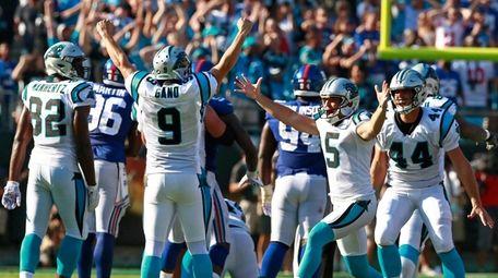 Panthers' Graham Gano (9) celebrates his game-winning, 63-yard