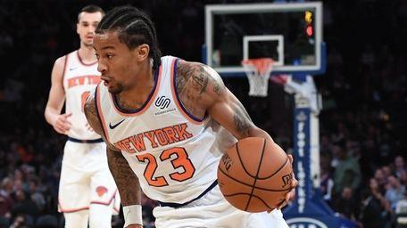 Knicks guard Trey Burke drives against the Pelicans