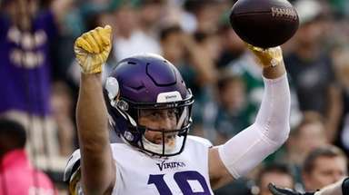Minnesota Vikings' Adam Thielen celebrates after scoring a