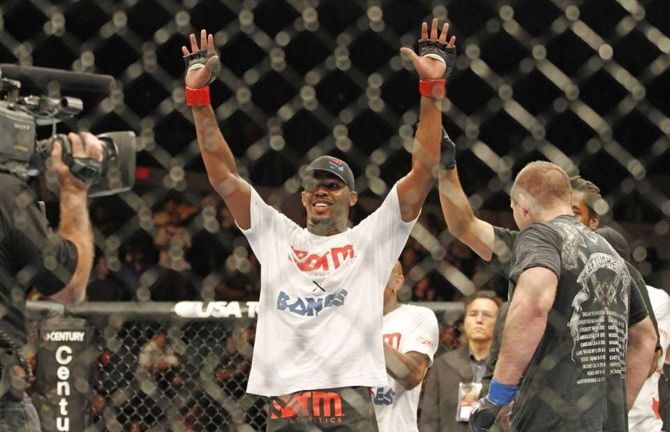 Jon Jones, center, celebrates after beating Vladimir Matyushenko,