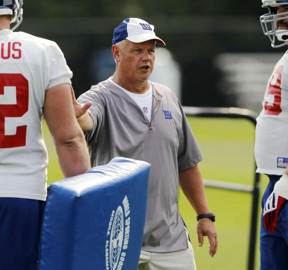 Giants offensive line coach Pat Flaherty talks to