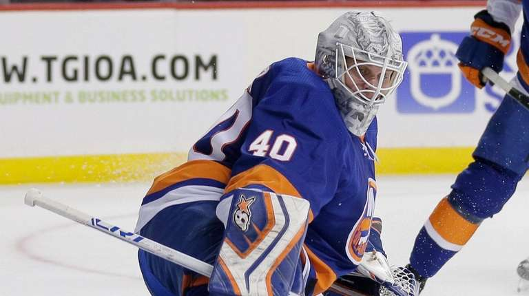 Islanders goaltender Robin Lehner deflects a shot during