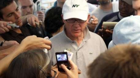 Jets owner Woody Johnson stops by the press