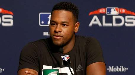 Yankees pitcher Luis Severino speaks to the media