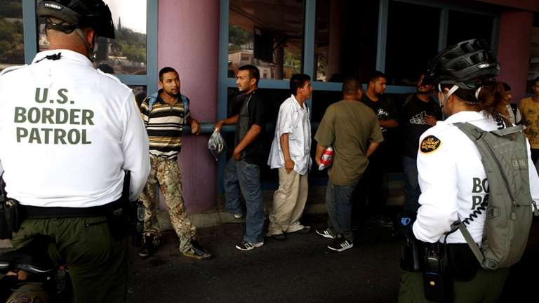 A group of illegal immigrants wait in line
