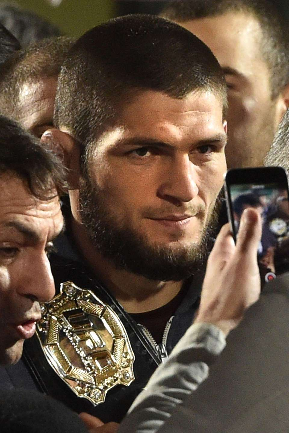 UFC lightweight champion Khabib Nurmagomedov of Russia carries