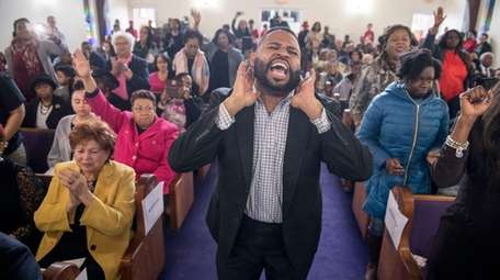 Aaron K. Marsh leads a gospel group at