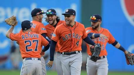 The Astros' George Springer and teammates celebrate after