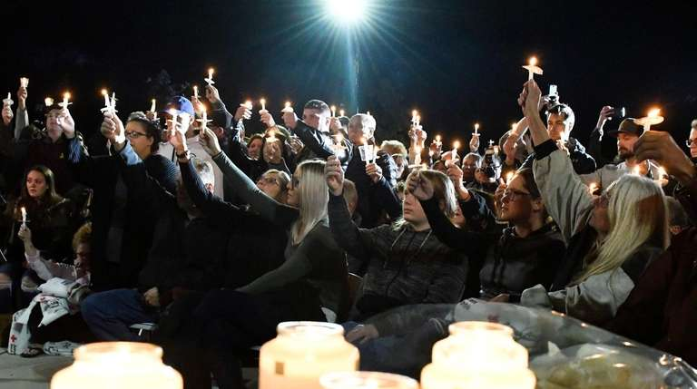 Family members and friends gather for a candlelight