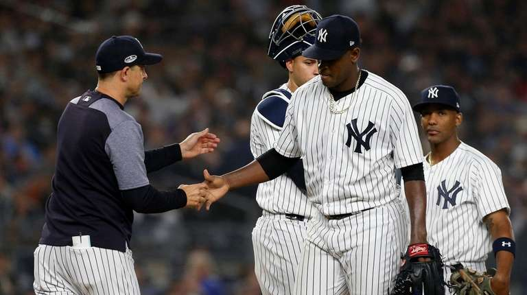 Aaron Boone takes the ball from Luis Severino