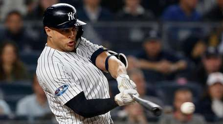Yankees DH Giancarlo Stanton connects on a second-inning
