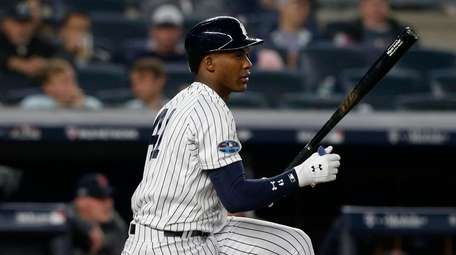 Miguel Andujar of the Yankees strikes out during