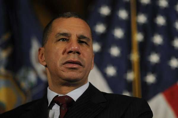 New York State Governor David Paterson holds a