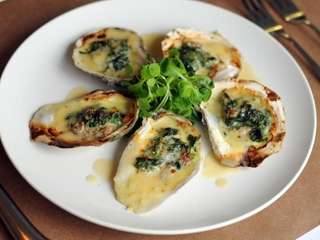Roasted local oysters are served at The Coast