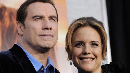 John Travolta, pictured with wife Kelly Preston. (Aug.