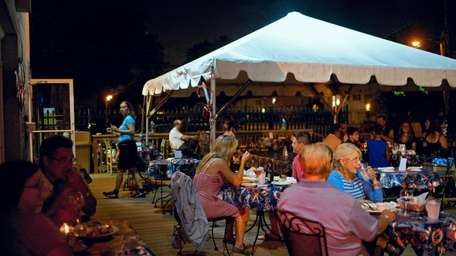 Diners outdoors on the patio at Ocean Grill,