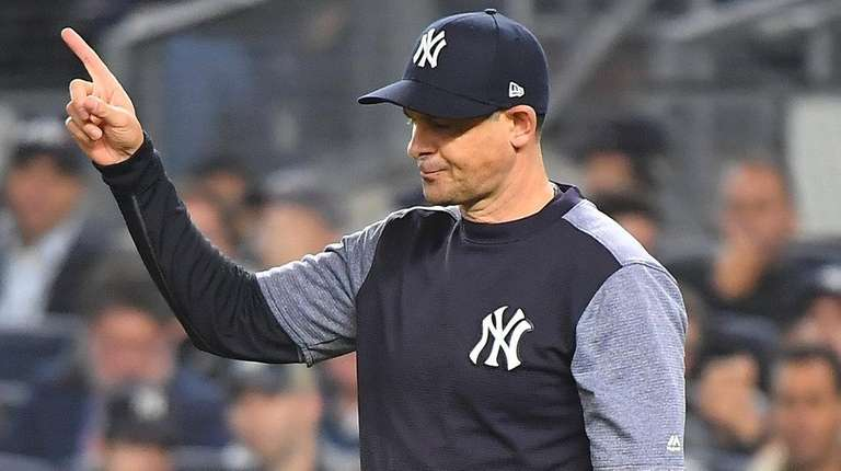 Yankees manager Aaron Boone calls to the bullpen