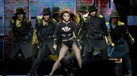 Paula Abdul performs with dancers at a