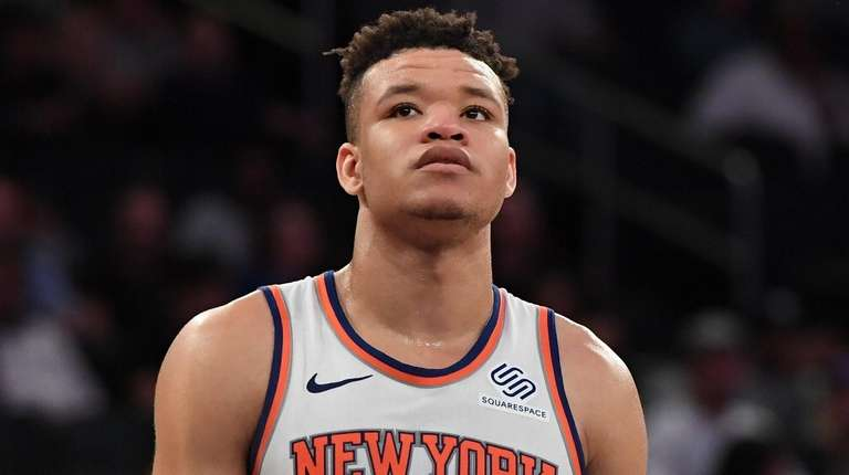 Knicks forward Kevin Knox looks on against the