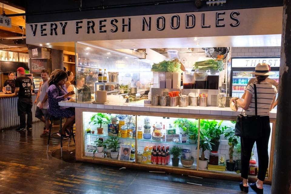 Customers dine at Very Fresh Noodles inside of