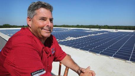 Scott Maskin, president of SUNation Solar Systems, shown