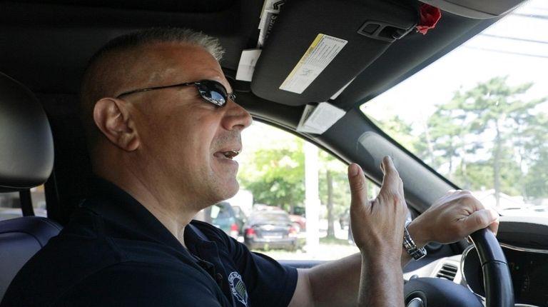 Former Suffolk County police detective John Oliva speaks