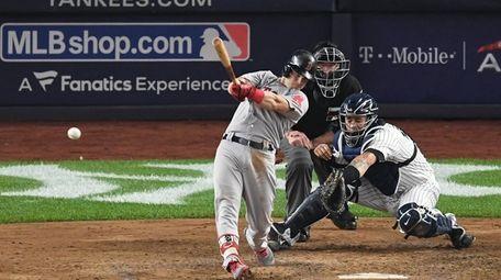 Boston Red Sox left fielder Andrew Benintendi hits