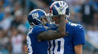 Odell Beckham Jr. celebrates with teammate Eli Manning