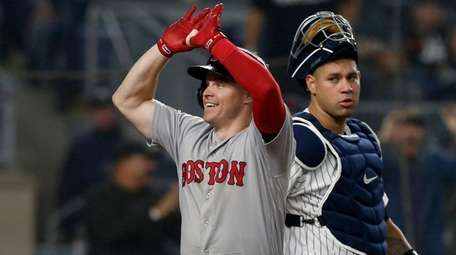 Brock Holt crosses home plate on his home