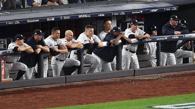 The Yankees dugout glumly watches Boston's Chris Sale